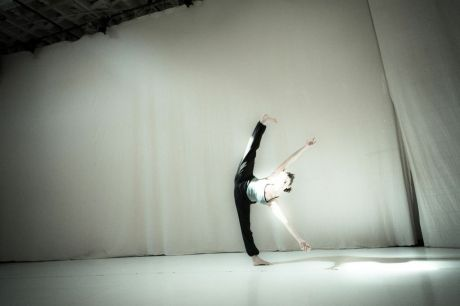 Playing with leg extension and flexibility in rehearsal